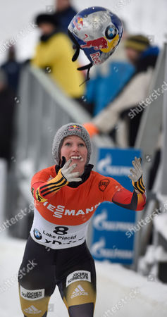 Stock Image of Anja Huber Selbach of Germany Tosses Her Helmet Following Her Final Run in the Women's Skeleton of the Fibt World Cup Bobsled and Skeleton at Mt Van Hoevenberg in Lake Placid New York Usa 12 December 2014 United States Lake Placid
