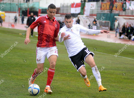Es Setif's Player Akram Djahnit (r) and Al-ahly Player Saadeldin Samir Saad Ali (l) Fight For the Ball During the 2015 Caf Super Cup Match Between Es Setif of Algeria and Al-ahly of Egypt at the Mustapha Tchaker Stadium in Blida Algeria 21 February 2015 Algeria Blida
