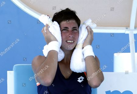 Carla Suarez Navarro of Spain Cools Down During a Break in Her Second Round Match Against Galina Voskoboeva of Kazakhstan at the Australian Open Grand Slam Tennis Tournament in Melbourne Australia 16 January 2014 Australia Melbourne
