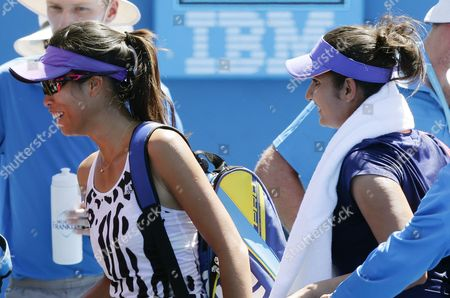 Su-wei Hsieh of Taiwan (l) and Women's Doubles Partner Sania Mirza of India (r) Leave After Winning Over Opponents Maria Irigoyen of Argentina and Romina Oprandi of Switzerland at the Australian Open Grand Slam Tennis Tournament in Melbourne Australia 21 January 2015 the Australian Open Tennis Tournament Goes From 19 January Until 01 February 2015 Australia Melbourne
