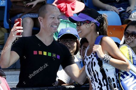 Stock Photo of Su-wei Hsieh (r) of Taiwan is Congratulated and Poses For a Selfie with a Fan After Winning in the Women's Doubles with Partner Sania Mirza of India (not Pictured) Over Opponents Maria Irigoyen of Argentina and Romina Oprandi of Switzerland at the Australian Open Grand Slam Tennis Tournament in Melbourne Australia 21 January 2015 the Australian Open Tennis Tournament Goes From 19 January Until 01 February 2015 Australia Melbourne