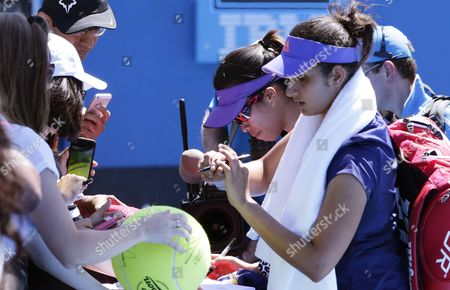 Su-wei Hsieh of Taiwan (back) and Women's Doubles Partner Sania Mirza of India (f) Sign Autographs After Winning Over Opponents Maria Irigoyen of Argentina and Romina Oprandi of Switzerland at the Australian Open Grand Slam Tennis Tournament in Melbourne Australia 21 January 2015 the Australian Open Tennis Tournament Goes From 19 January Until 01 February 2015 Australia Melbourne