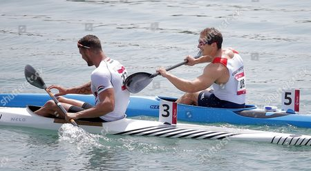 Stock Picture of Gold Medalist Miklos Dudas of Hungary (l) and Bronzemedalist Ed Mckeever of Great Britain (r) Celebrate After the Kayak Single (k1) 200m Men's Final of the 2015 European Games in Mingachevir About 300 Kilometres West of Baku Azerbaijan 16 June 2015 Azerbaijan Mingachevir