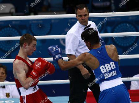 Dzmitry Asanau (red) of Belarus in Action Against Qais Ashfaq (blue) of Great Britain During Their 56kg Men's Semi Final Bout at the Baku 2015 European Games in Baku Azerbaijan 24 June 2015 Azerbaijan Baku