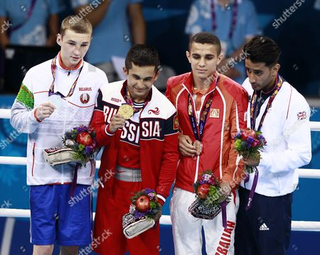 (l-r) the Silver Medalist Dzmitry Asanau of Belarus the Gold Medalist Bakhtovar Nazirov of Russia the Bronze Medalists Tayfur Aliyev of Azerbaijan and Qais Ashfaq of Great Britain Pose on the Podium During the Medal Ceremony of 56kg Men's Final Bout at the Baku 2015 European Games in Baku Azerbaijan 25 June 2015 Azerbaijan Baku