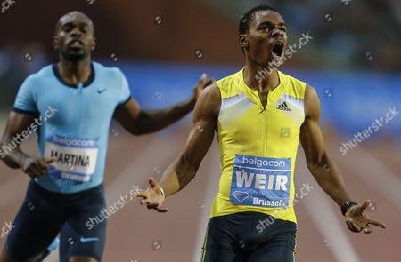 Warren Weir From Jamaica (r) Reacts After Winning the Men 200m Race Next to Walter Dix From the U S (l) During the Memorial Van Damme Iaaf Diamond League International Athletics Meeting in Brussels Belgium 6 September 2013 Belgium Brussels