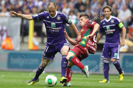 Rsc Anderlecht's Milan Jovanovic (l) in Action Against Zulte's Jonathan Delaplace (r) During the Belgian Jupiler Pro League Soccer Match Between Rsc Anderlecht and Zulte Waregem in Brussels Belgium 19 May 2013 Belgium Brussels