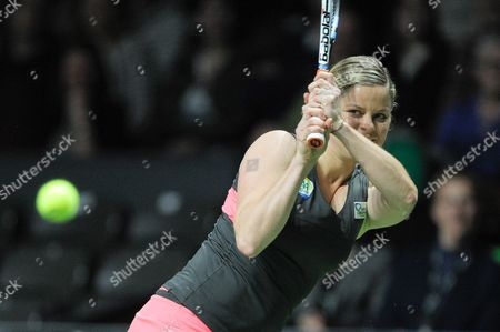 Stock Picture of Belgian Tennis Player Kim Clijsters is Playing with Belgian Dick Norman Against Belgian Players Sabine Appelmans and Xavier Malisse During an Exhibition Match of Belgian Legends Doubles Ahead to Final of Wta Tennis Match of the Bnp Parisbas Fortis Diamond Games in Antwerp Belgium 14 February 2015 Belgium Antwerp