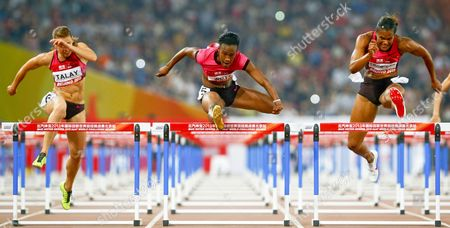 Stock Image of Kellie Wells (c) of the Usa is on Her Way to Win the Women's 100m Hurdles Final During the 2013 Iaaf World Challenge Athletics Event at the Olympic National Stadium Better Known As the Birds Nest in Beijing China 21 May 2013 at Left Alina Talay of Belarus China Beijing