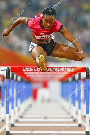 Kellie Wells of the Usa is on Her Way to Win the Women's 100m Hurdles Final During the 2013 Iaaf World Challenge Athletics Event at the Olympic National Stadium Better Known As the Birds Nest in Beijing China 21 May 2013 China Beijing