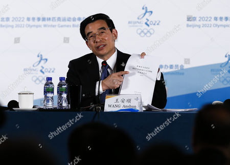 Wang Anshun Mayor of Beijing and President of the Beijing 2022 Bid Committee Holds a Document While Answering Questions During a Press Conference at a Conference Hall in Beijing China 28 March 2015 the International Olympic Committee (ioc) Evaluation Commission Conducted a Five-day Inspection of Proposed Games Venues in Beijing and Hebei Province For the 2022 Olympic and Paralympic Winter Games China Beijing