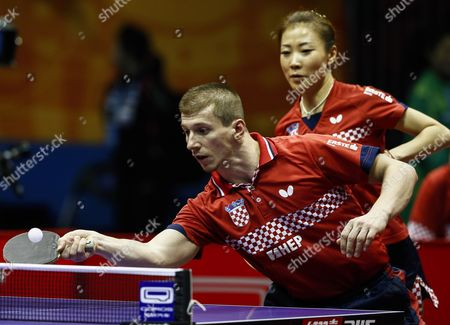 Tomislav Kolarek (l) and Tian Yuan (r) of Croatia in Action Against Natalia Partyka and Wang Zengyi of Poland During the Second Round of the Mixed Doubles in the 2015 World Table Tennis Championships at Suzhou International Expo Center in Suzhou Jiangsu Province China 27 April 2015 China Suzhou