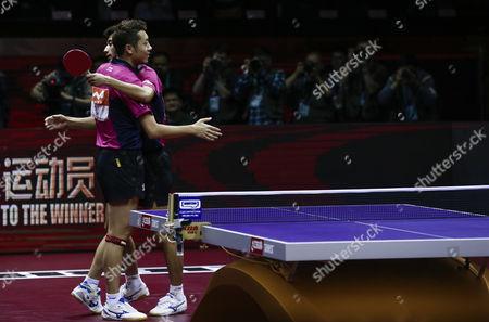 Xu Xin (l) and Zhang Jike (r) of China React After Defeating Fan Zhendong and Zhou Yu of China in the Finals Match of Men's Doubles of the 2015 World Table Tennis Championships at the Suzhou International Expo Center in Suzhou Jiangsu Province China 02 May 2015 China Suzhou