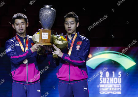 Stock Image of Zhang Jike (l) and Xu Xin (r) of China Hold Their Championship Trophy After Defeating Fan Zhendong and Zhou Yu of China in the Finals Match of Men's Doubles of the 2015 World Table Tennis Championships at the Suzhou International Expo Center in Suzhou Jiangsu Province China 02 May 2015 China Suzhou