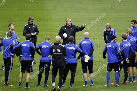 Finish National Soccer Team Head Coach (c) Mixu Paatelainen Talks to His Players During Their Training Session at Stade De France Stadium in Saint-denis Near Paris France on 14 October 2013 France Will Face Finland in the Fifa World Cup 2014 Qualifying Soccer Match on 15 October 2013 France Saint Denis