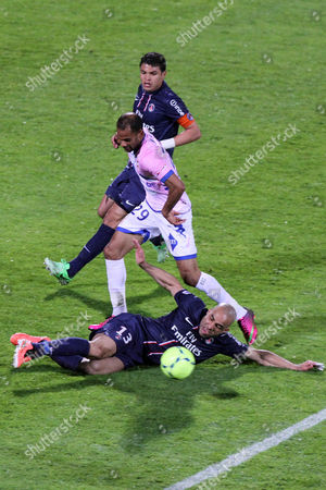 Saber Khalifa (l) of Evian Vies For the Ball with Thiago Silva and Christophe Jallet (r) of Paris Saint Germain During the French League 1 Soccer Match Between Evian Thonon Gaillard and Psg at Parc Des Sports in Annecy France 28 April 2013 France Annecy
