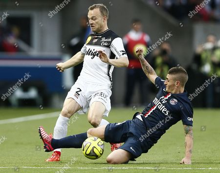En Avant Guingamp's Lars Jacobsen (l) Fights For the Ball with Paris St Germain's Marco Verratti During the French Ligue 1 Soccer Match Between Paris Saint-germain (psg) and Ea Guingamp at the Parc Des Princes Stadium in Paris France 08 May 2015 France Paris