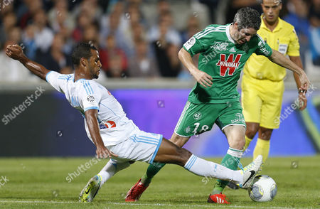 Olympique Marseille's Jacques-alaixys Romao (l) Vies For the Ball with As Saint Etienne's Fabien Lemoine (r) During the French Ligue 1 Soccer Match Between Olympique Marseille and As Saint Etienne at the Velodrome Stadium in Marseille France 24 September 2013 France Marseille