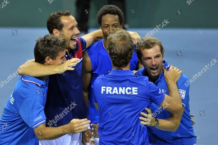 (l Tor) French Davis Cup Team Coach Arnaud Clement Michael Llodra Gael Monfils Undentified Team Member Julien Benneteau of France Celebrate After Monfils Beats Peter Gojowczyk of Germany During the Day Three's Single Match of the Davis Cup World Group Quarter-final Match Between France and Germany at Sport's Arena Jean Weille in Nancy Eastern France 06 April 2014 France Win the Quarter-final by 3 Games to 2 Against Germany France Nancy