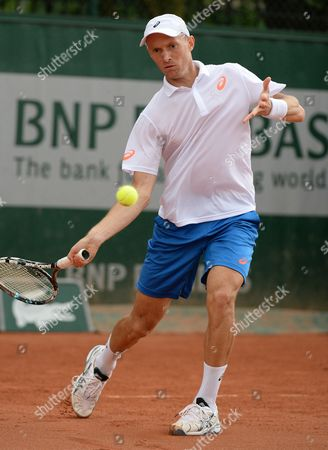 Nikolay Davydenko of Russia Returns to Robin Haase of the Netherlands During Their First Round Match For the French Open Tennis Tournament at Roland Garros in Paris France 26 May 2014 France Paris