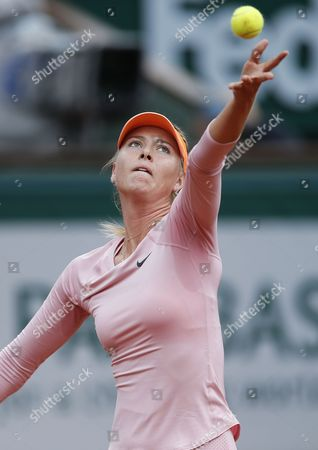Maria Sharapova of Russia Serves to Compatriot Ksenia Pervak During Their First Round Match For the French Open Tennis Tournament at Roland Garros in Paris France 26 May 2014 France Paris