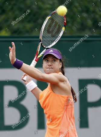 Sorana Cirstea of Romania Returns to Aleksandra Wozniak of Canada During Their First Round Match For the French Open Tennis Tournament at Roland Garros in Paris France 27 May 2014 France Paris