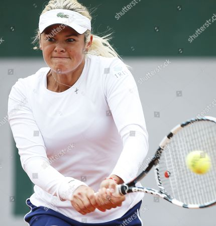 Aleksandra Wozniak of Canada Returns to Sorana Cirstea of Romania During Their First Round Match For the French Open Tennis Tournament at Roland Garros in Paris France 27 May 2014 France Paris