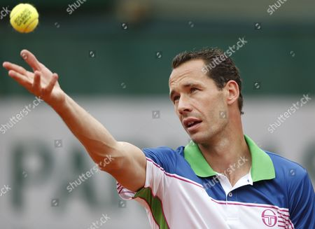 Michael Llodra of France Serves to Fernando Verdasco of Spain During Their First Round Match For the French Open Tennis Tournament at Roland Garros in Paris France 27 May 2014 France Paris