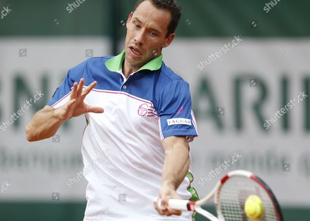 Michael Llodra of France Returns to Fernando Verdasco of Spain During Their First Round Match For the French Open Tennis Tournament at Roland Garros in Paris France 27 May 2014 France Paris