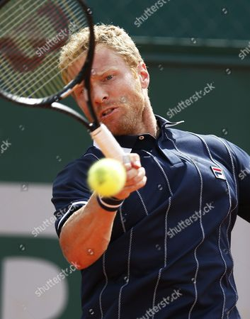 Stock Photo of Dmitry Tursunov of Russia Returns to Potito Starace of Italy During Their First Round Match For the French Open Tennis Tournament at Roland Garros in Paris France 25 May 2014 France Paris