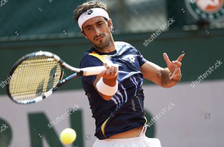 Potito Starace of Italy in Action Against Dmitry Tursunov of Russia During Their First Round Match For the French Open Tennis Tournament at Roland Garros in Paris France 25 May 2014 France Paris