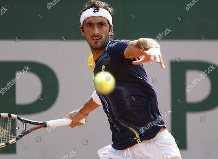 Stock Image of Potito Starace of Italy in Action Against Dmitry Tursunov of Russia During Their First Round Match For the French Open Tennis Tournament at Roland Garros in Paris France 25 May 2014 France Paris