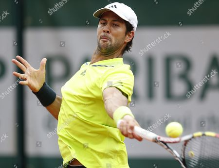 Fernando Verdasco of Spain Returns to Michael Llodra of France During Their First Round Match For the French Open Tennis Tournament at Roland Garros in Paris France 27 May 2014 France Paris