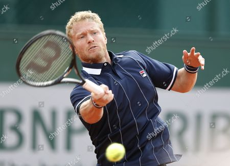 Dmitry Tursunov of Russia Returns to Potito Starace of Italy During Their First Round Match For the French Open Tennis Tournament at Roland Garros in Paris France 25 May 2014 France Paris