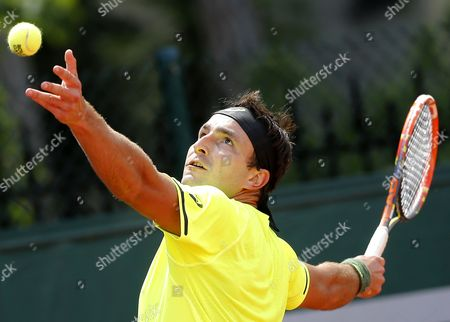 Marinko Matosevic of Australia in Action Against Thomaz Bellucci of Brazil During Their First Round Match For the French Open Tennis Tournament at Roland Garros in Paris France 25 May 2015 France Paris