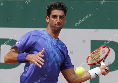 Thomaz Bellucci of Brazil in Action Against Marinko Matosevic of Australia During Their First Round Match For the French Open Tennis Tournament at Roland Garros in Paris France 25 May 2015 France Paris
