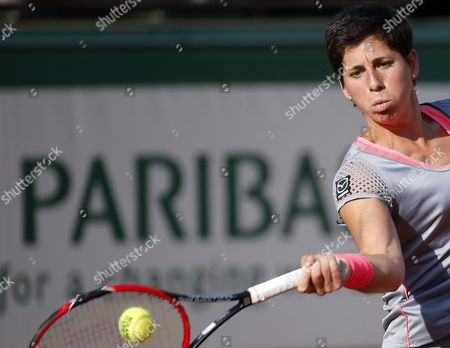 Carla Suarez Navarro of Spain in Action Against Virginie Razzano of France During Their Second Round Match For the French Open Tennis Tournament at Roland Garros in Paris France 27 May 2015 France Paris