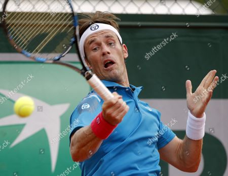 Daniel Gimeno-traver of Spain in Action Against David Ferrer of Spain During Their Second Round Match For the French Open Tennis Tournament at Roland Garros in Paris France 28 May 2015 France Paris