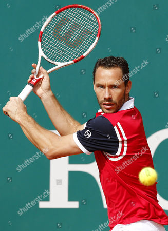 Michael Llodra of France Returns the Ball to Jerzy Janowicz of Poland During Their First Round Match at the Monte-carlo Rolex Masters Tournament in Roquebrune Cap Martin France 15 April 2014 France Roquebrune Cap Martin