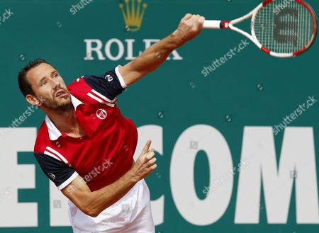 Michael Llodra of France Serves to Jerzy Janowicz of Poland During Their First Round Match at the Monte-carlo Rolex Masters Tournament in Roquebrune Cap Martin France 15 April 2014 France Roquebrune Cap Martin