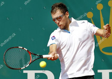 Jerzy Janowicz of Poland Returns the Ball to Michael Llodra of France During Their First Round Match at the Monte-carlo Rolex Masters Tournament in Roquebrune Cap Martin France 15 April 2014 France Roquebrune Cap Martin