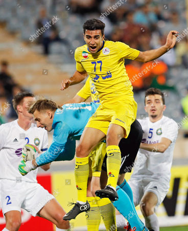 Naft's Arsalan Motahari (top) in Action Against Pakhtakor Goal Keeper Lobanov Alexander (bottom) During the Afc Champions League Group B Soccer Match Between Iran's Naft Tehran and Uzbekistan's Pakhtakor Fc at Azadi Stadium in Tehran Iran 22 April 2015 Iran (islamic Republic Of) Tehran