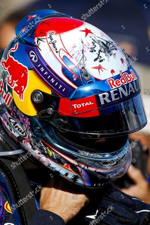 A Red Star is Seen on Top of the Helmet of German Formula One Driver Sebastian Vettel of Red Bull Racing As a Tribute of Late Spanish Racing Driver Maria De Villota who Died on 11 October 2013 in Seville Spain Before the Start of the Japanese Formula One Grand Prix at the Suzuka Circuit in Suzuka Japan 13 October 2013 Japan Suzuka