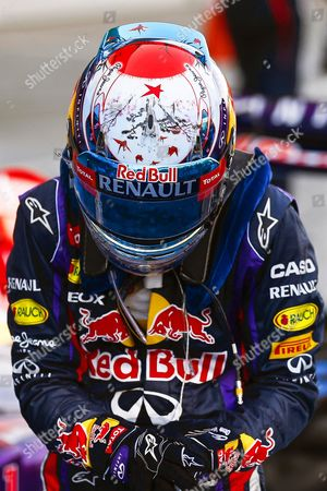 A Red Star is Seen on Top of the Helmet of German Formula One Driver Sebastian Vettel of Red Bull Racing As a Tribute to Late Spanish Racing Driver Maria De Villota who Died on 11 October 2013 in Seville Spain Before the Start of the Japanese Formula One Grand Prix at the Suzuka Circuit in Suzuka Japan 13 October 2013 Japan Suzuka
