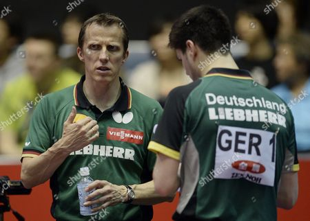 Germany's Men National Team Coach Joerg Rosskopf (l) Leads His Player Dimitrij Ovtcharov During His Men's Team Competition First Round Match Against Yang Zi of Singapore For the Table Tennis Team World Championships in Tokyo Japan 28 April 2014 Japan Tokyo