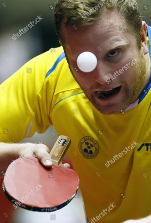 Jens Lundqvist of Sweden Serves the Ball Against Yang Zi of Singapore During the Men's Team Event of the Table Tennis Team World Championships in Tokyo Japan 02 May 2014 Singapore Defeated Sweden to Advance to the Quarterfinals Japan Tokyo