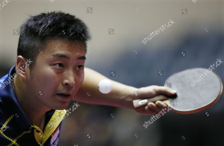 Yang Zi of Singapore Serves the Ball Against Jens Lundqvist of Sweden During the Men's Team Event of the Table Tennis Team World Championships in Tokyo Japan 02 May 2014 Singapore Defeated Sweden to Advance to the Quarterfinals Japan Tokyo