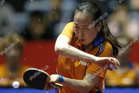 Stock Image of Li Jiao of the Netherlands in Action Against Huang Yi-hua of Taiwan During Her Women's Team Tournament Match Between Taiwan and the Netherlands of the Table Tennis Team World Championships in Tokyo Japan 02 May 2014 Japan Tokyo