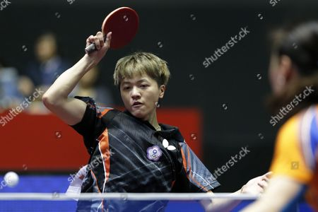 Stock Photo of Huang Yi-hua of Taiwan in Action Against Li Jiao of the Netherlands During Her Women's Team Tournament Match Between Taiwan and the Netherlands of the Table Tennis Team World Championships in Tokyo Japan 02 May 2014 Japan Tokyo