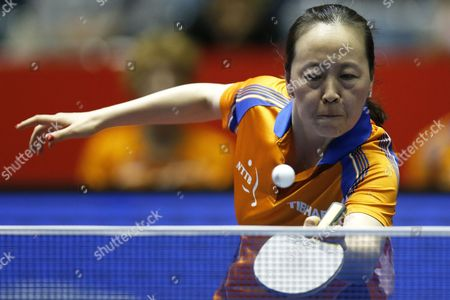 Li Jiao of the Netherlands in Action Against Huang Yi-hua of Taiwan During Her Women's Team Tournament Match Between Taiwan and the Netherlands of the Table Tennis Team World Championships in Tokyo Japan 02 May 2014 Japan Tokyo